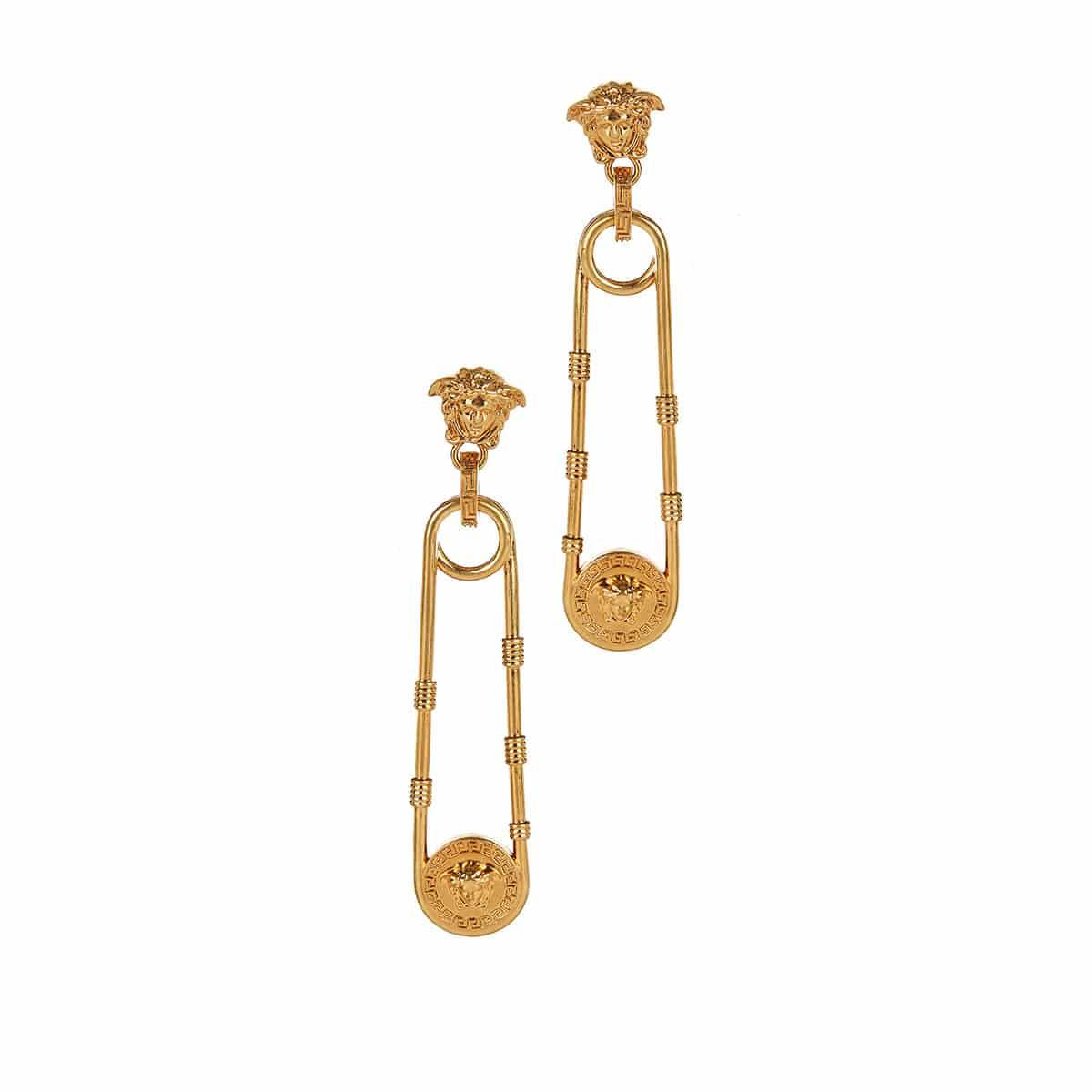 Medusa pin-shaped earrings