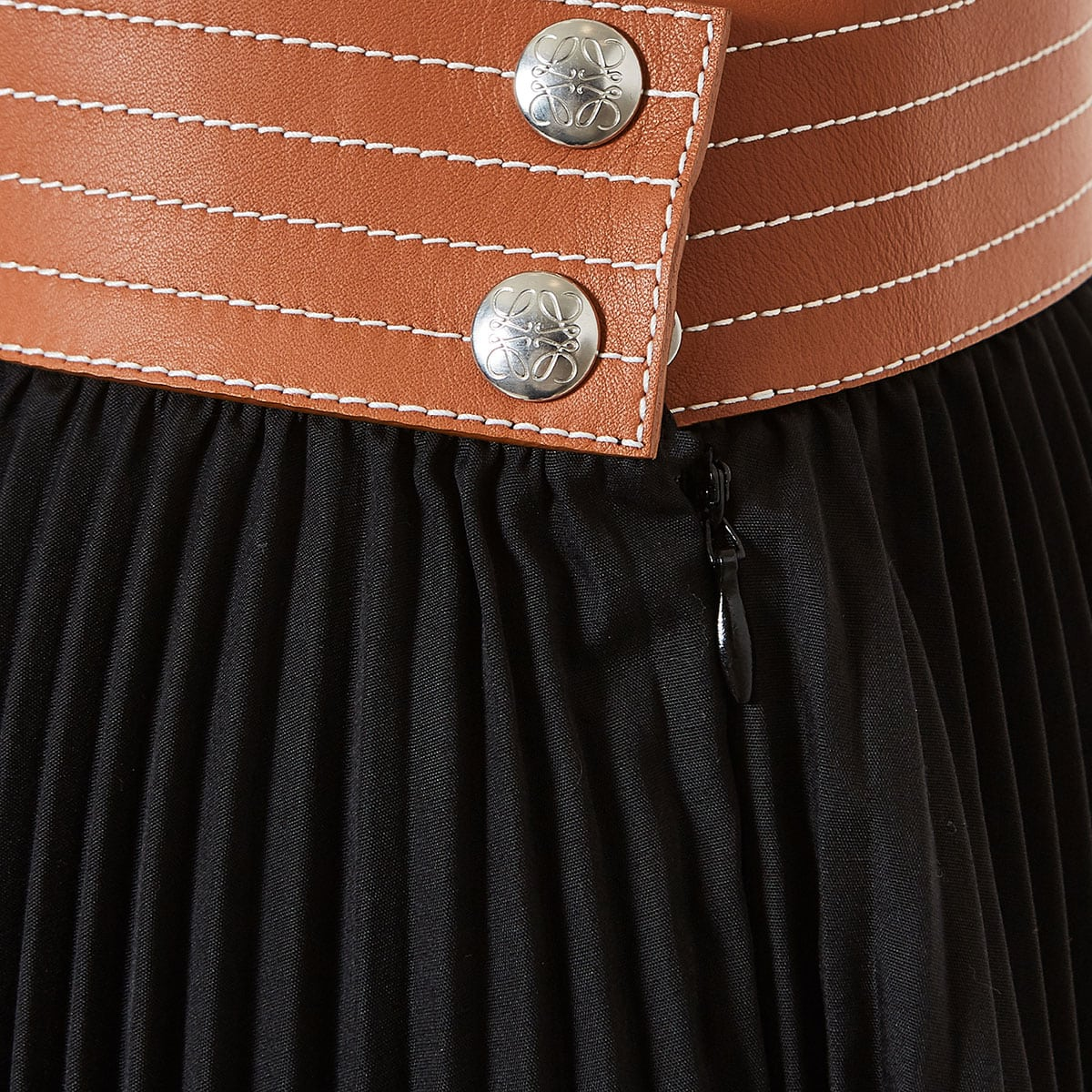 Leather-trimmed asymmetric pleated skirt