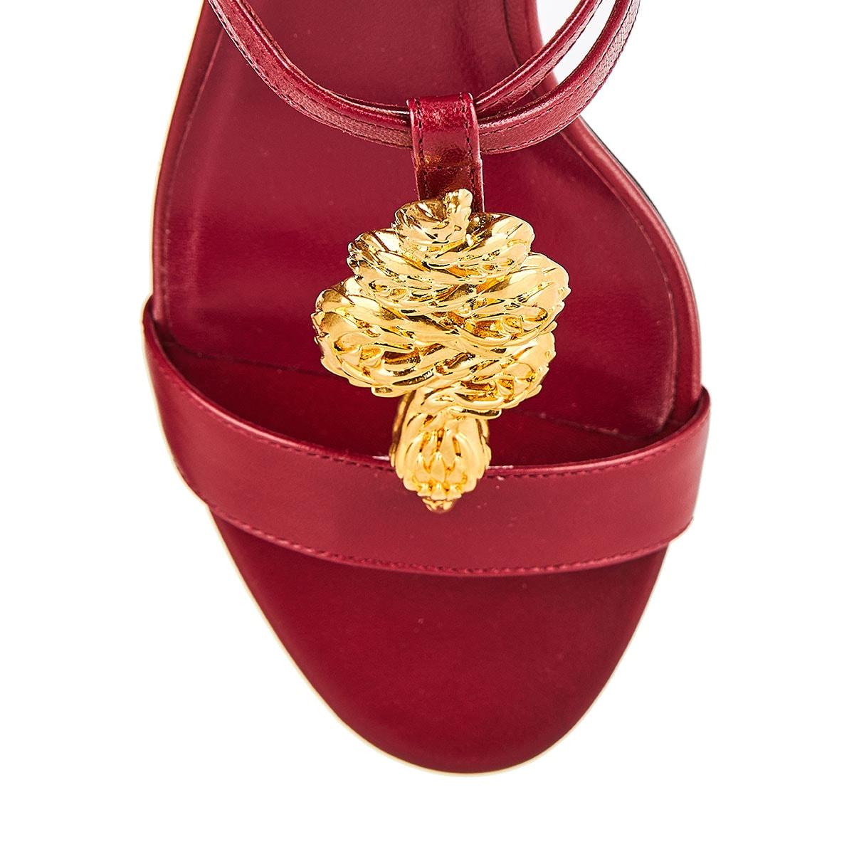 Snake-embellished leather sandals