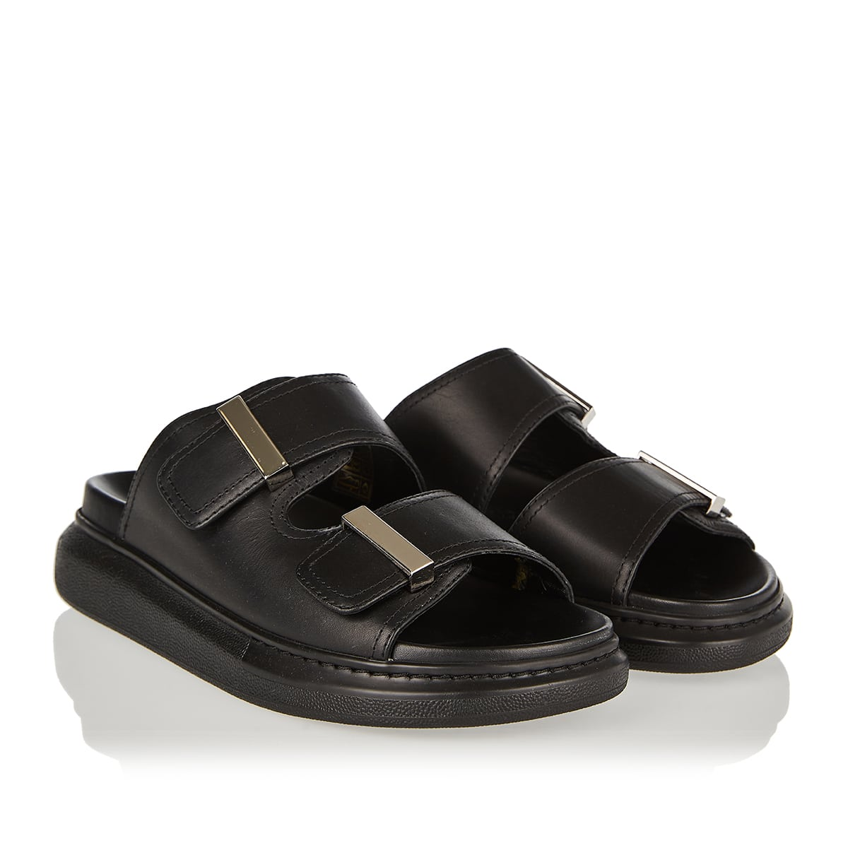 Oversized-sole leather slides