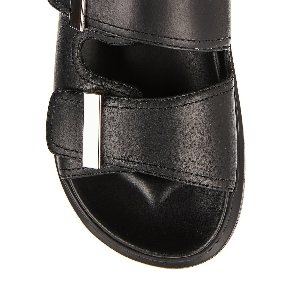 Oversized-sole leather slides