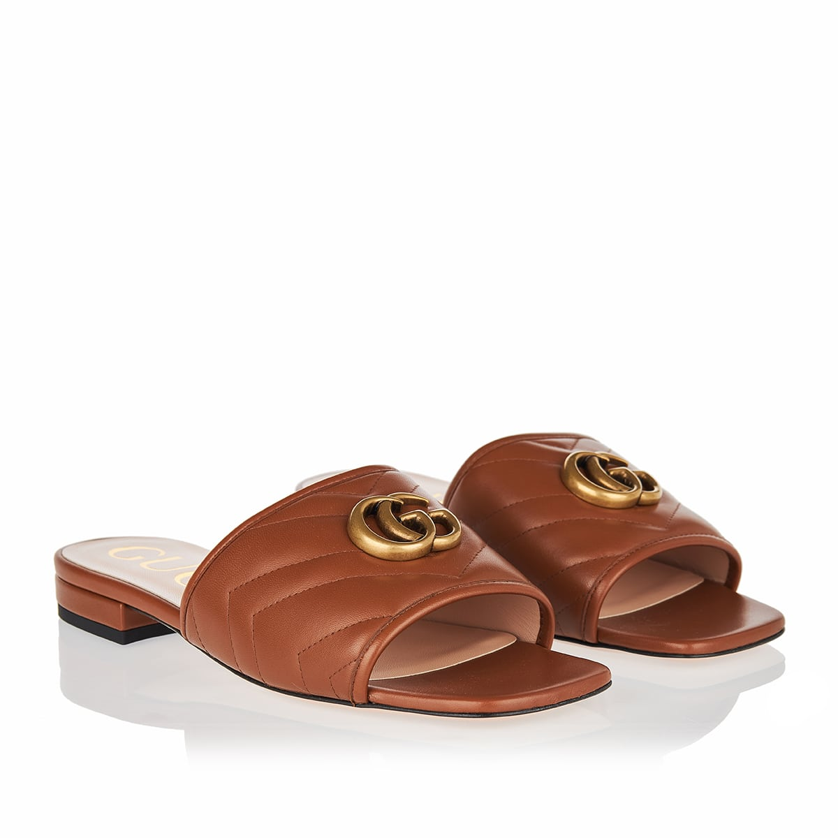 GG quilted leather slides