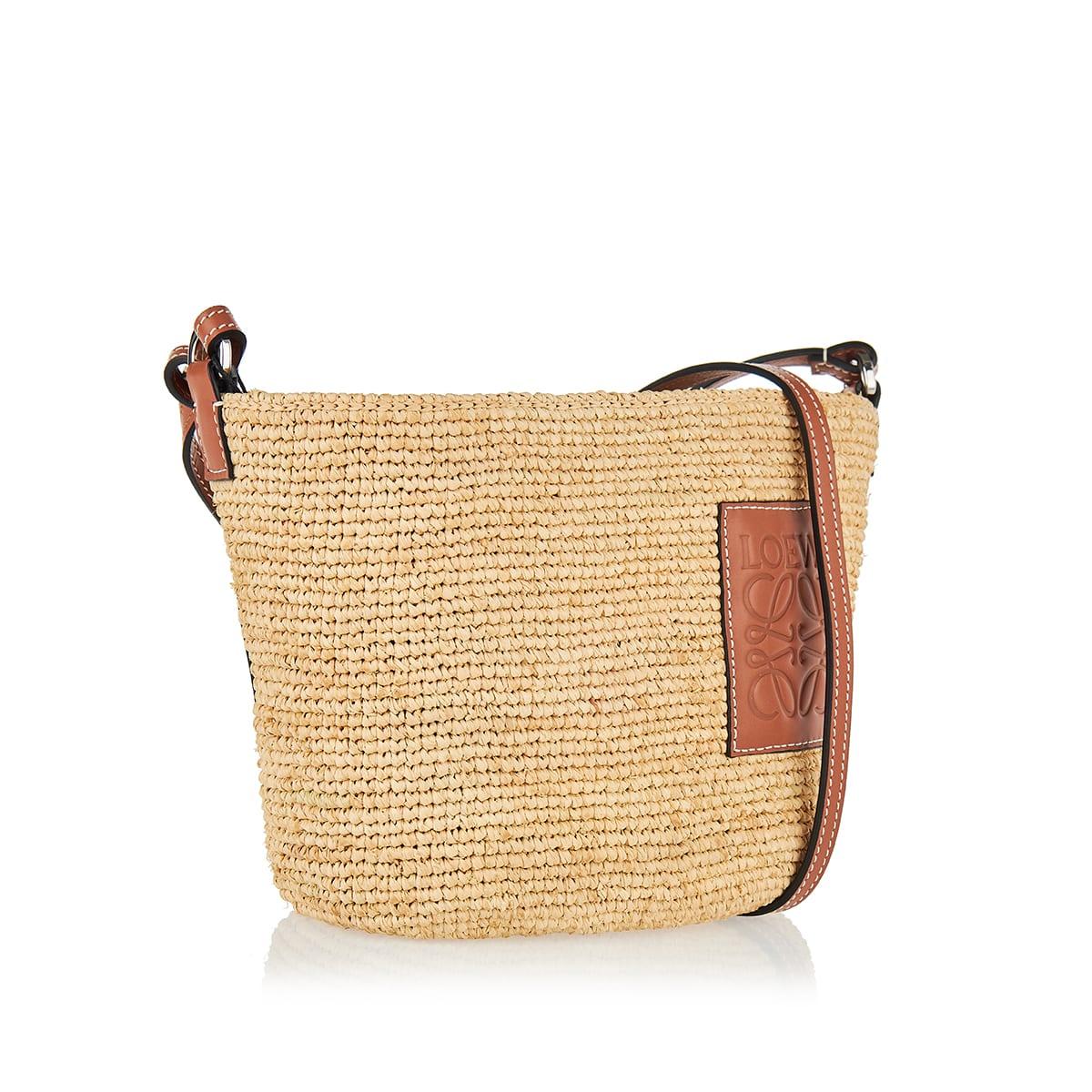 Leather-trimmed raffia bag