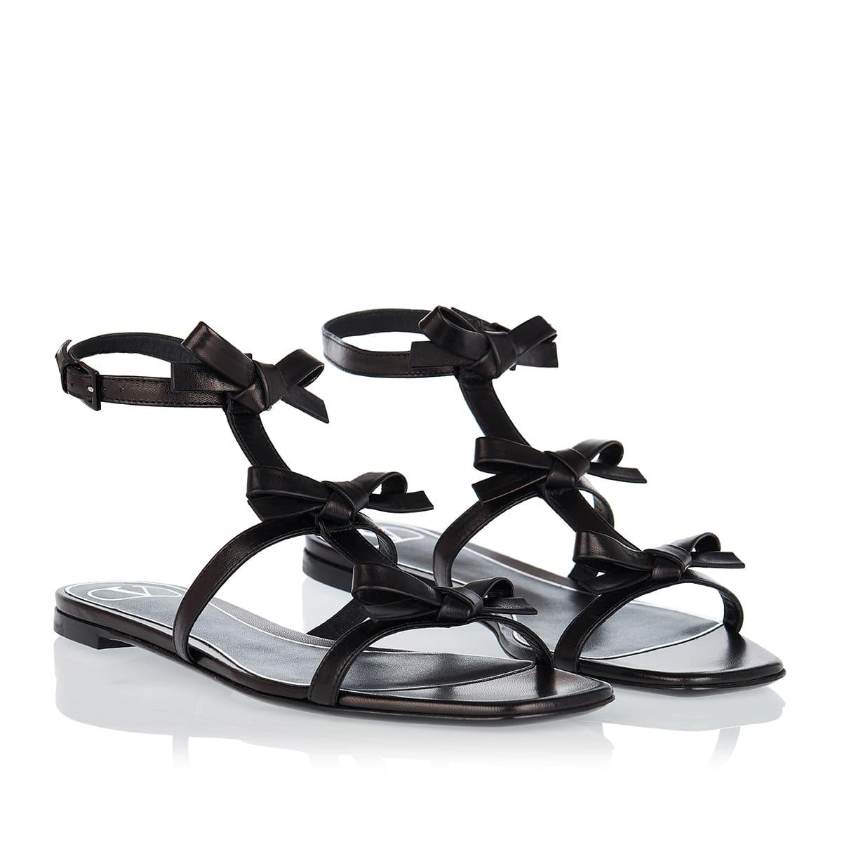 Bow-embellished leather flat sandals